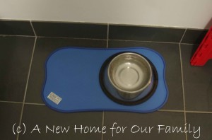 Dog bowl floor protector