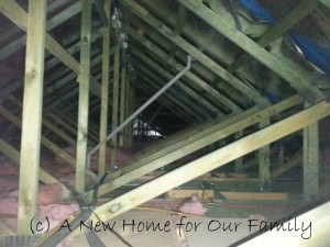 Insulation removed due to water damage when the box gutter was blocked by hail